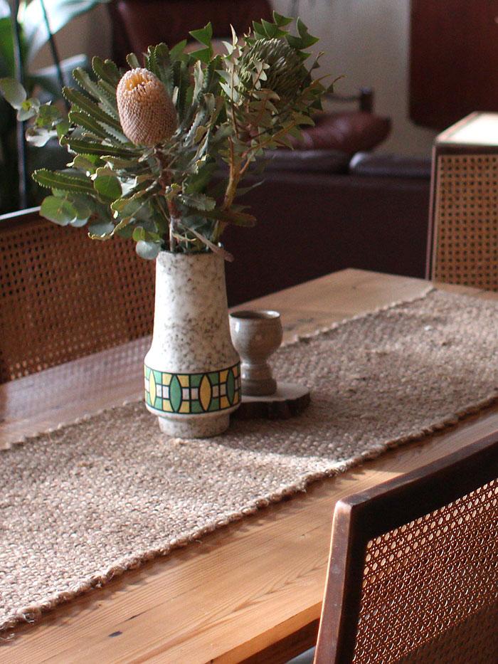 Vintage vase and banksias