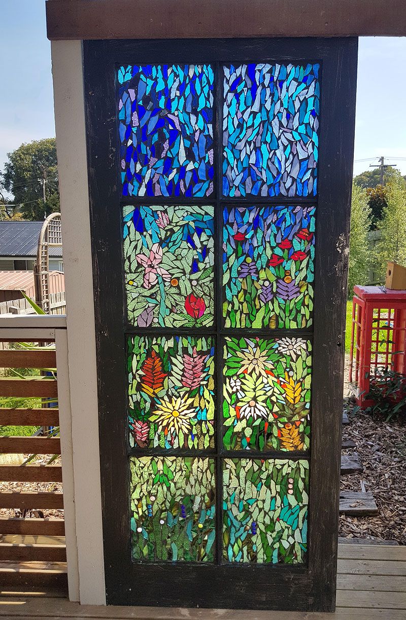 Beautiful wildflower upcycled glass mosaic on secondhand door by Lisa Gill